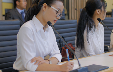 Students in a boardroom setting